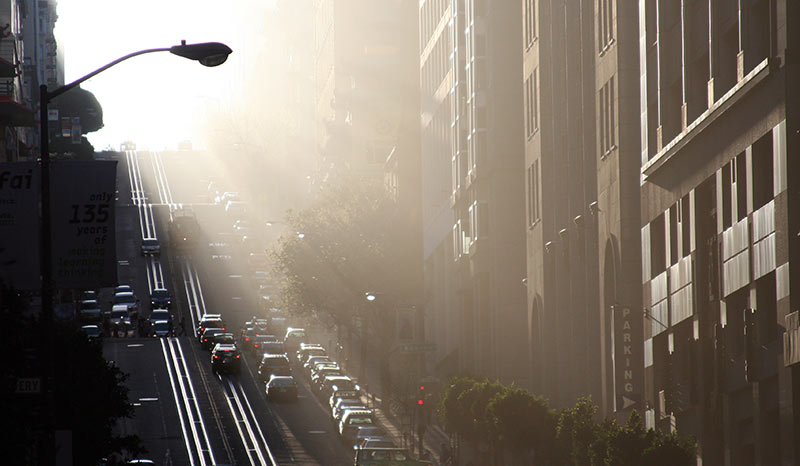 Looking up California Street to Nob Hill with fog, naturally